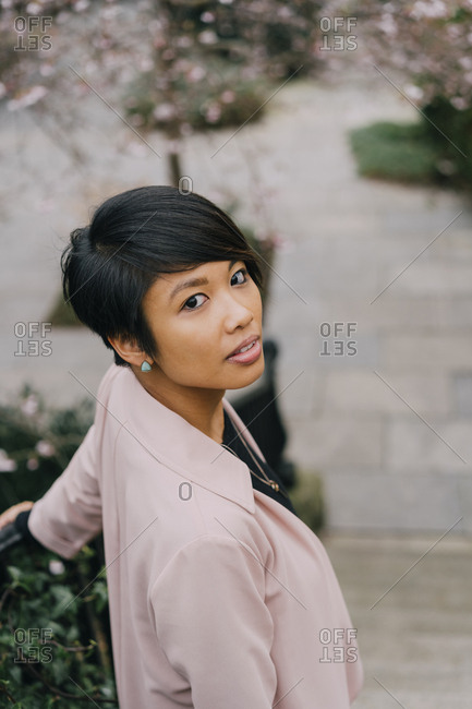 Young beautiful Asian woman walking in the park