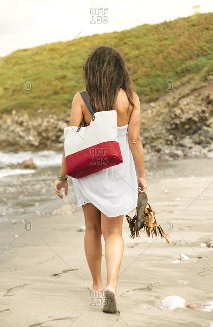 Woman walking a beach in Spain