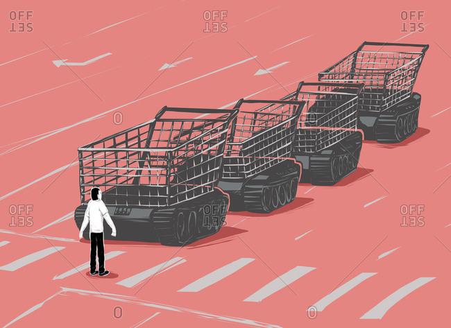 Man blocking an army of shopping carts as tanks