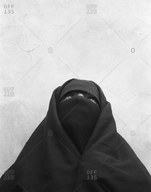 Essaouira, Morocco - November 30, 2015: A portrait of a Moroccan Muslim woman wearing a burqa