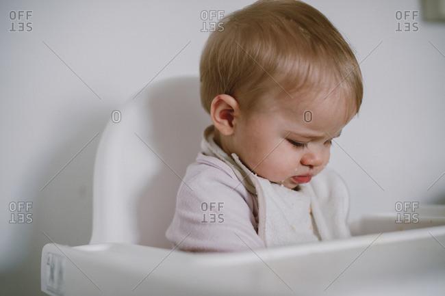 Cute baby sitting in high-chair
