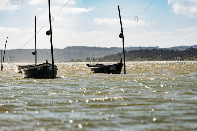 Lagoa de Obidos, Portugal - February, 21, 2015: Boats on water in lagoon