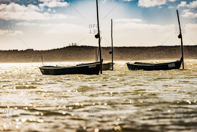 Lagoa de Obidos, Portugal - February, 21, 2015: Boats on shimmering water