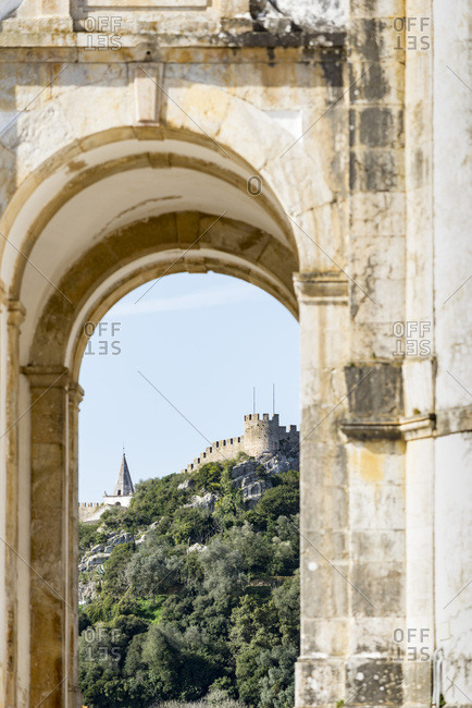 Castle seen through arch, Portugal