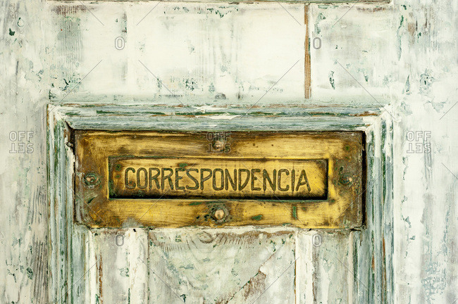 Close up of mail slot on door, Portugal