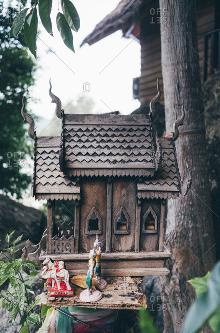 Figurines on a small, outdoor shrine in Koh Lipe, Thailand