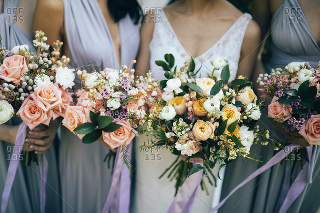 Bride and bridesmaids holding their bouquets