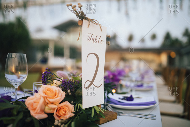 Table number on an outdoor table at a wedding reception