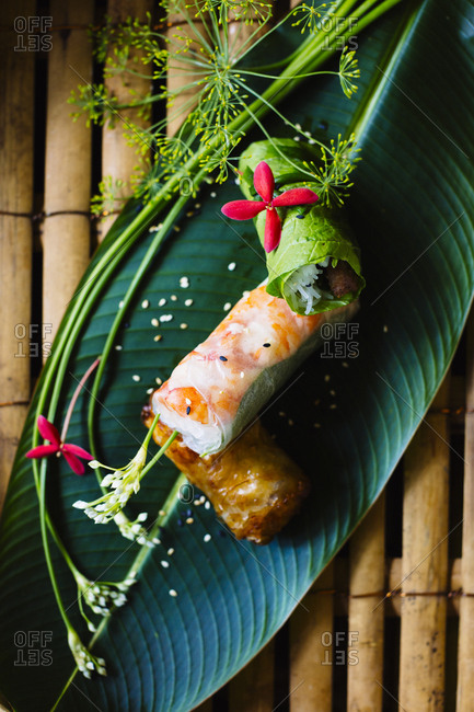 Vietnamese spring rolls served on a banana leaf