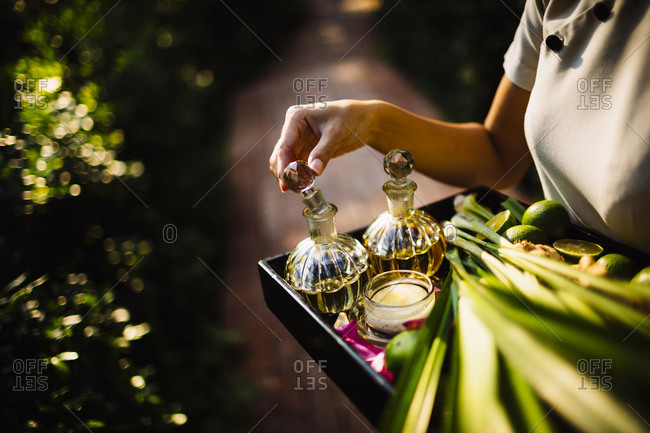 Woman carrying a tray of oils at a luxury spa resort in southern Vietnam