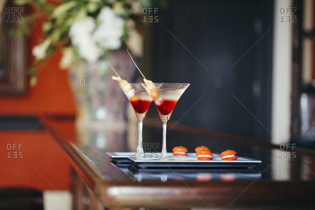 Cocktails and macaroons at the check-in desk of a luxury resort