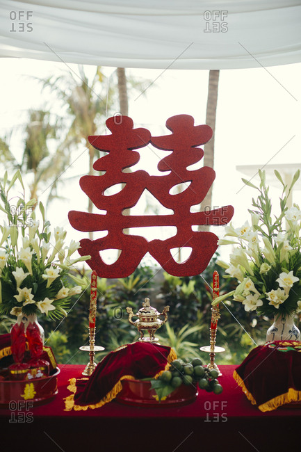 Chinese double happiness symbol on a wedding table at a beachside resort