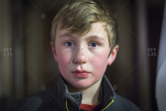 Portrait of a blond boy with blue eyes and rosy cheeks