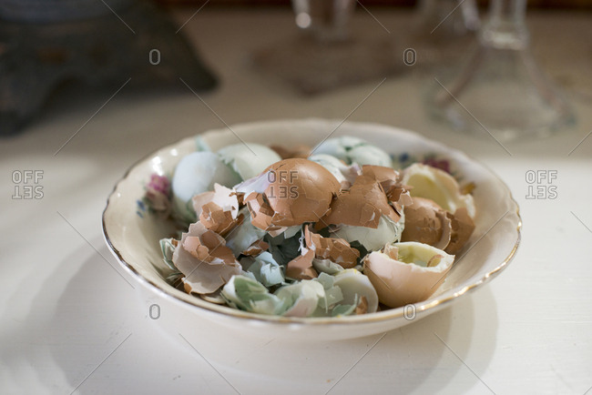 Broken egg shells in a bowl