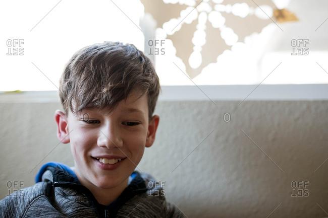 Portrait of a smiling brunette boy looking away