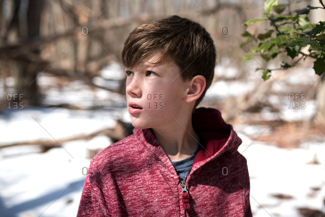 Boy standing outside on a winter day