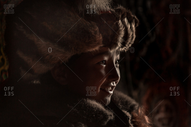 Altai Mountains, Mongolia - July 18, 2016: Portrait of a Kazak girl in a traditional winter coat and hat