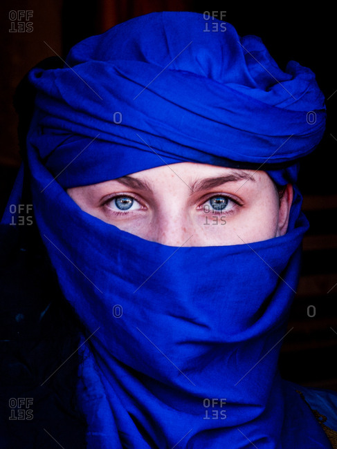 Marrakech, Morocco - May 11, 2010: Portrait of a Caucasian woman with a blue head scarf and blue eyes