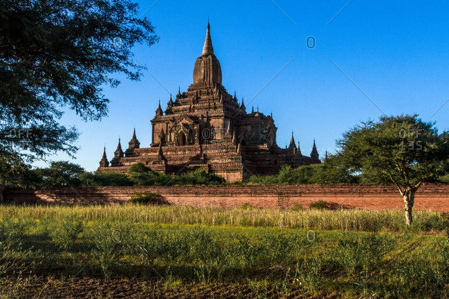 Buddhist temple behind a stone wall in Old Bagan, Myanmar