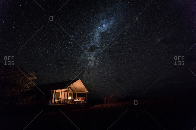 Milky Way in the sky above a cabin in the desert in Damaraland, Namibia