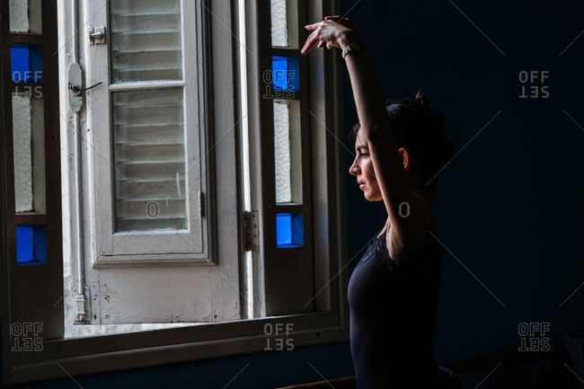 Havana, Cuba - January 21, 2016: Ballet dancer looking out window