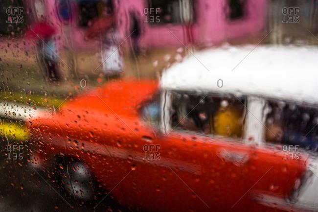 Old car seen through rainy window, Havana, Cuba
