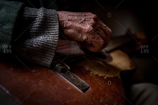 Old man's hand playing a guitar, Havana, Cuba