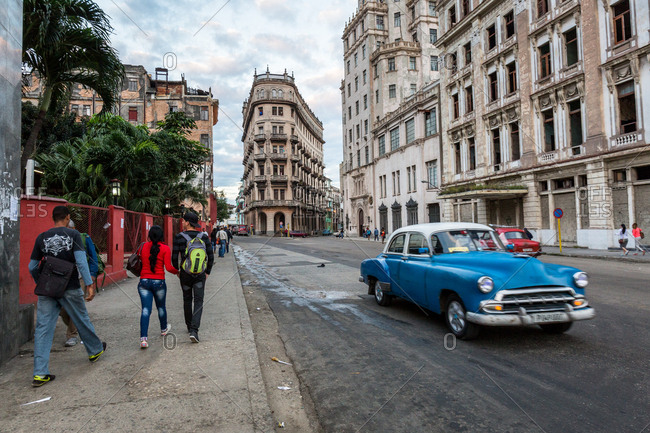 Havana, Cuba - January 26, 2016: Cars and pedestrians in street