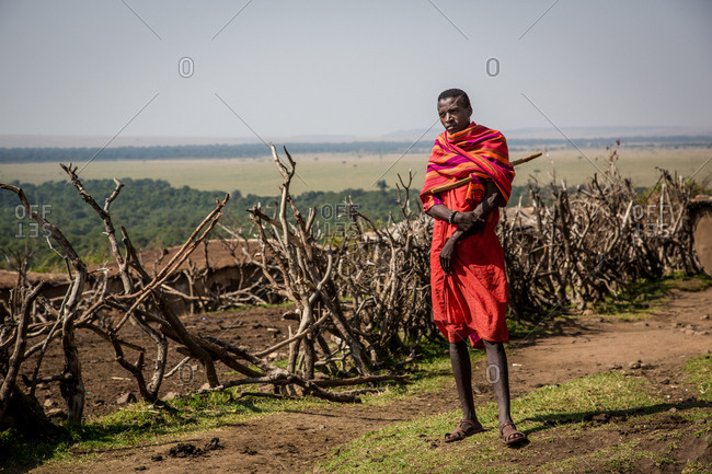 Maasai Mara, Kenya - September 6, 2013: Maasai man near a handmade animal pen, Kenya