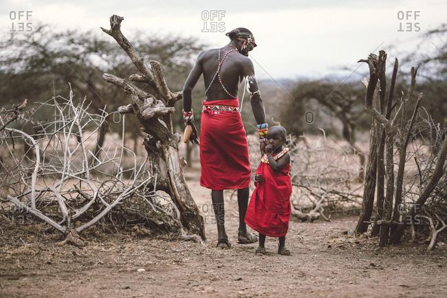 Samburuland, Kenya - September 20, 2015: Samburu warrior pats girl on back, Kenya