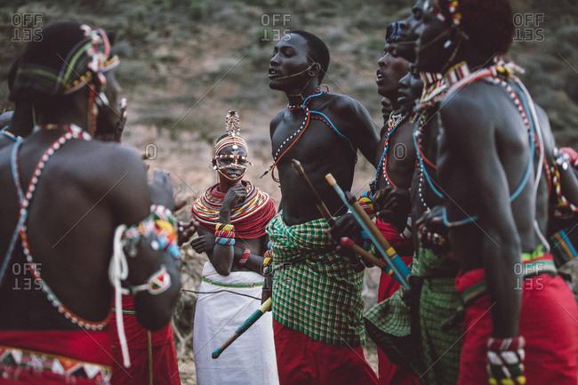 Samburuland, Kenya - September 20, 2015: Samburu warriors dancing as girls watch