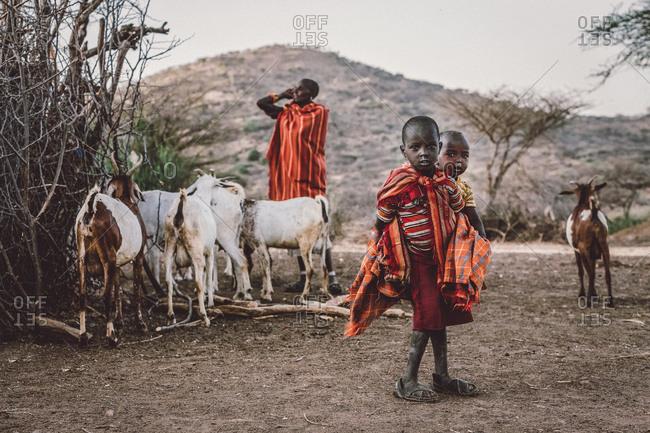 Samburuland, Kenya - September 20, 2015: Samburu children near goats, Kenya