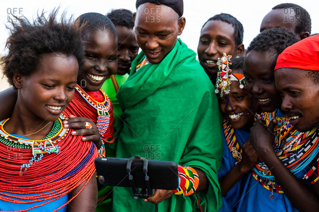 Samburuland, Kenya - September 18, 2015: Samburu people watching themselves on phone
