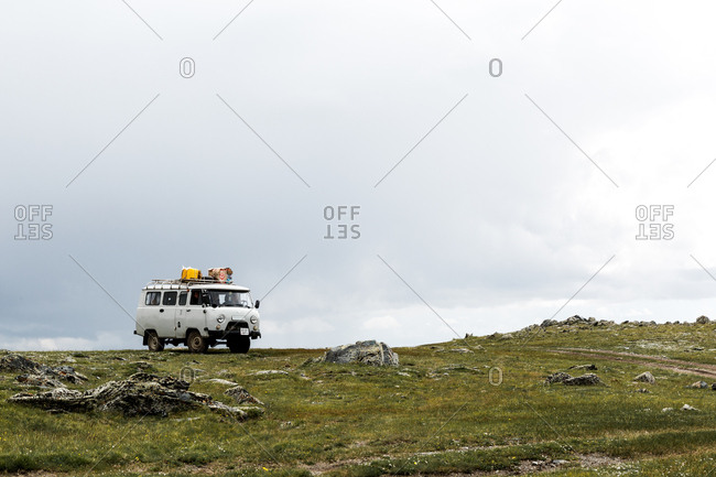 Altai Mountains, Mongolia - July 11, 2016: Van driving off road, Altai Mountains, Mongolia