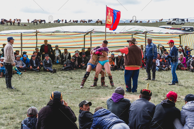 Altai Mountains, Mongolia - July 11, 2016: Wrestlers at wedding while guests watch, Mongolia
