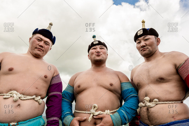 Altai Mountains, Mongolia - July 11, 2016: Three Kazakh wrestlers in Altai Mountains, Mongolia
