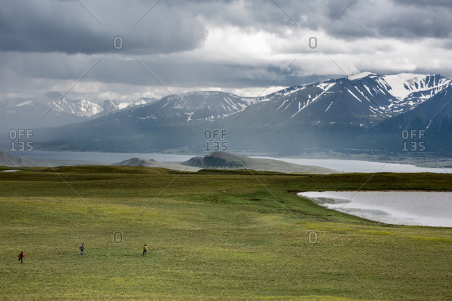 Children playing in valley of Altai Mountains, Mongolia