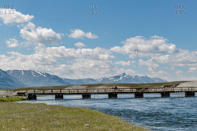 Man on horseback crossing bridge, Altai Mountains, Mongolia