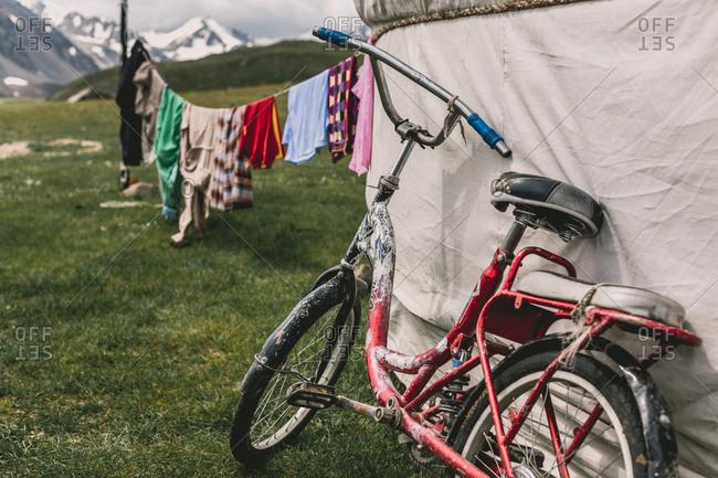 Altai Mountains, Mongolia - July 16, 2016: Bike on Kazakh tent in rural mountains