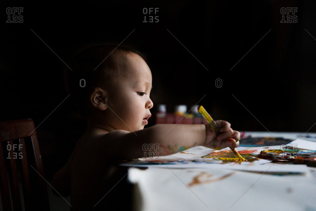Baby boy painting a picture