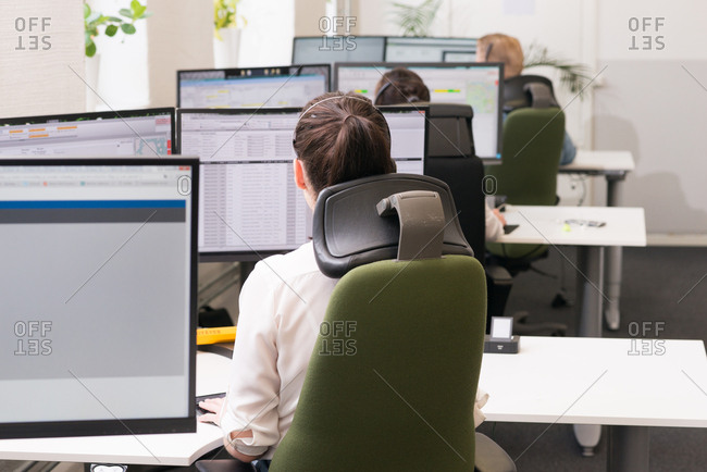 Rear view of workers on their computers in an office