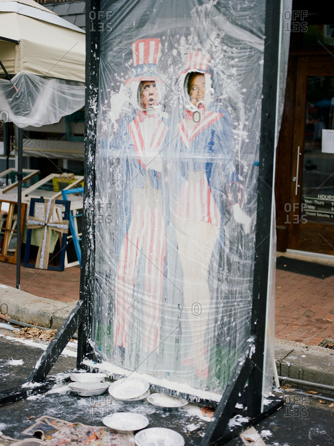 """Pittsboro, North Carolina - March 24, 2017: A carnival game of """"Pie in the Face"""" depicting 2016 political figures covered in whipped cream pie"""
