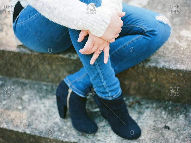 Woman sitting on a stone curb