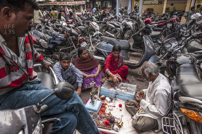 Bhopal, India - February 1, 2013: Old town, artisan working in a motorcycles parking