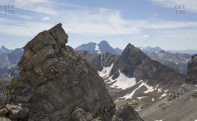Summit view of rocks and distant peaks
