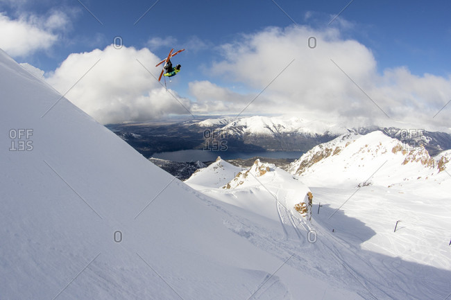Professional Skier Hits A Backcountry Jump And Catches A Big Air In The Backcountry Around Cerro Catedral In Argentina