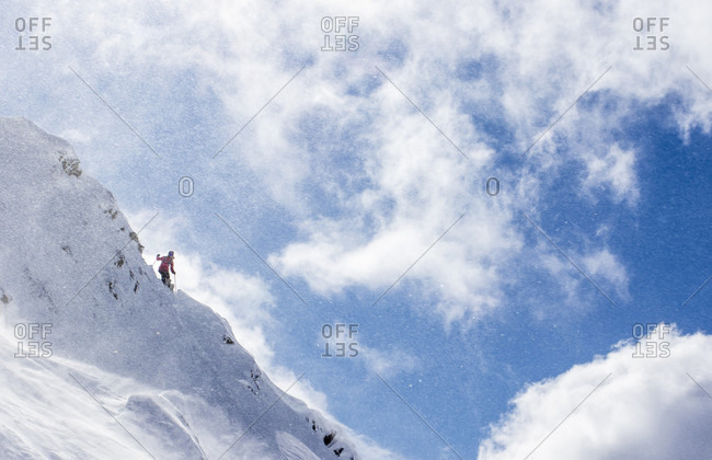 Professional Skier Standing On A Ridge And Spots Her Line Before Dropping At Cerro Catedral In Argentina