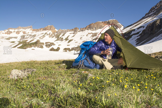 A Man Sitting In His Tent In The Morning While Camping In Ice Lake Basin, Colorado