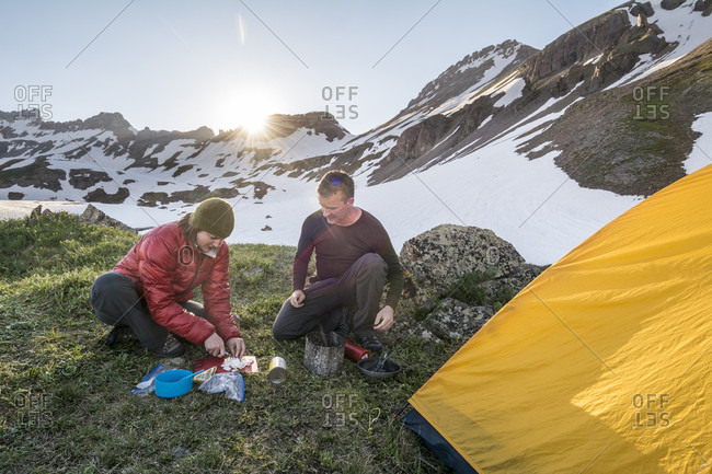 A Husband And His Wife Preparing A Meal While Camping In The Ice Lakes Basin