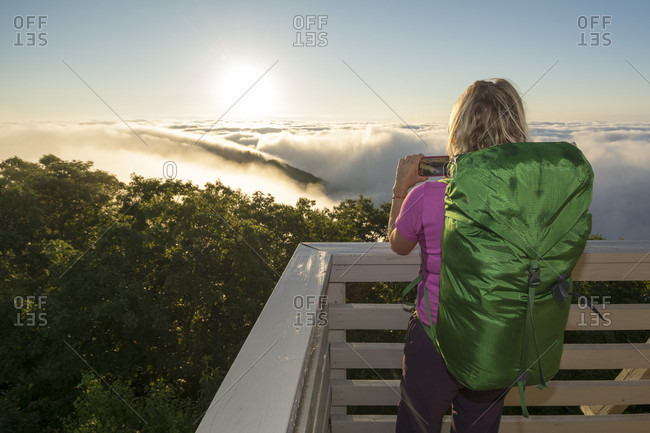 A Woman Enjoy Taking Picture During A Foggy Morning At The Green Knob Firetower, Celo, North Carolina